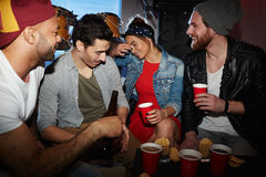 Party People Relaxing in Underground Club Royalty Free Stock Image