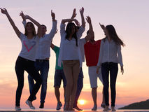 Party people on sunset royalty free stock photo