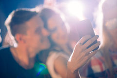 Party people taking selfie. In the nightclub royalty free stock images
