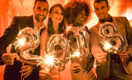 Party people women and men celebrating new years eve 2018. With sparklers and Champagne stock image