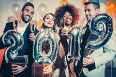 Party people women and men celebrating new years eve 2019. With sparklers and Champagne royalty free stock photography