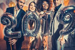 Party people women and men celebrating new years eve 2019. With sparklers and Champagne royalty free stock image
