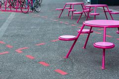 Party place, cafe on the street. There are tables, chairs in the marked places on the sidewalk, near the parking stock photos
