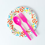 Party plate with spoon and fork Royalty Free Stock Image