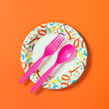 Party plate with spoon and fork Royalty Free Stock Images