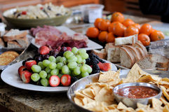 Party platter. With a variety of foods. Short depth of field; focus on grapes Stock Images
