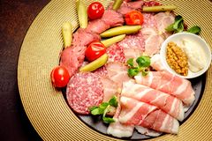Party Platter of Assorted Cured Meats with sauce and pickles stock images