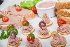 Party platter with slices of bread with home made pate, decorated with vegetables Stock Images