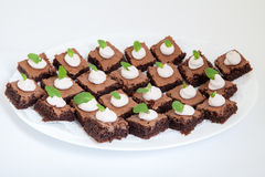 Party platter with small chocolate cakes Royalty Free Stock Photo