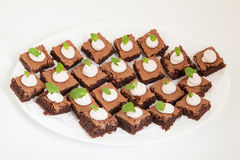 Party platter with small chocolate cakes Royalty Free Stock Photography