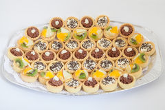Party platter with small cupcakes with different stuffing. Food catering Royalty Free Stock Photos
