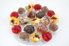 Party platter with variations of small cakes with different stuffing Royalty Free Stock Photos
