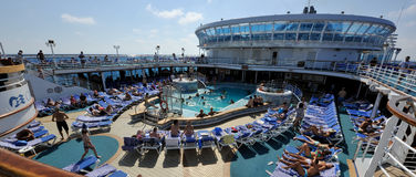 Party at poolside cruise ship. Party at the poolside of cruise ship. Summer, august on Mediterranean sea with cruise ship Crown Princess Royalty Free Stock Photography