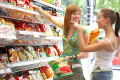 Party prep. Two friends while shopping  all brandmarks removed Stock Image