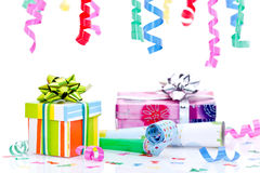 Party presents and streamers. Colorful gift boxes, blowers, confetti and streamer decorations for a party royalty free stock images