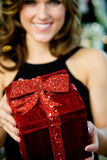 Party: Pretty Woman Holding Christmas Gift Royalty Free Stock Photography