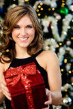 Party: Pretty Woman Holding Christmas Gift Stock Photography