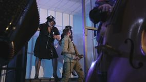 A party in the prison cell. Female officers dance. Musicians play on accordion and double bass. Slow motion. for music clip stock video footage
