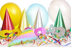 Party props. Party cone caps, streamers, pipes, balloons and carnival masks stock photography