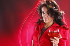 Party punch. Cute brunette enjoys a glass of party punch Royalty Free Stock Image