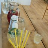 Party refreshment with lemonade in a jar. And straws Stock Photos
