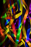 Party ribbons. Colourful ribbons lit against a dark background Stock Photography