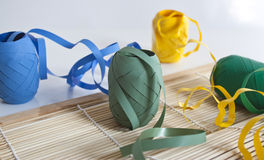 Party ribbons and place setting. Some colourful party ribbons spread across a table Stock Image