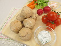 Party rolls, cherry tomatoes, red radishes, carrots and dipping sauce Stock Photography