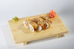 Party rolls on wooden tray Stock Images