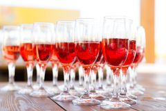 Party row of champagne glasses on a table Stock Images
