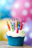 Party's over. Cupcake with extinguished birthday candles stock image