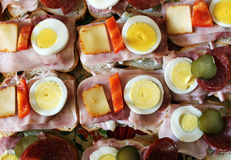 Party sandwiches with ham, cheese, egg and pepper. Photo of party sandwiches with ham, cheese, egg and pepper royalty free stock image