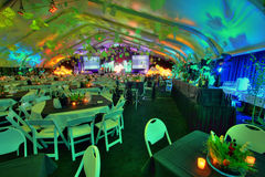 Party Set for Large Group. A large group of 800 people party room table set inside a tent with bars Stock Photos