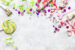 Party set with lollipop and confetti on stone background top view mock up Royalty Free Stock Photos