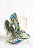 Party shoes. Woman high heel party shoes and champagne glass Royalty Free Stock Photos