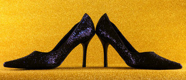 Party shoes. A close up of sparkling black stiletto heel shoes stock photo