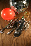 Party shoes on floor with champagne glass stock images