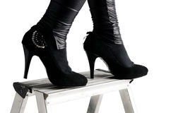 Party shoes on ladder Royalty Free Stock Photo