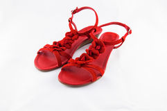 Party Shoes. Sandal type shoes and red color adorned with flowers of the same color for parties and special ceremonies stock images