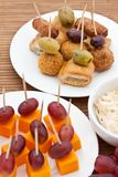 Party snacks. Mini sausage rolls and cheese Stock Photos