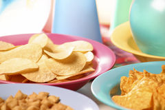 Party snacks: Nachos and Chips Stock Photo