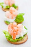 Party snacks. Prawns on a bed of lettuce & cheese Stock Photos