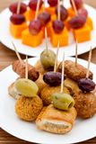 Party snacks. Sausage rolls, olives & cheese Royalty Free Stock Photo