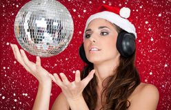 Party in snow, disco ball and girl with santa hat Stock Photography