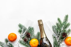 Party with spruce, tangerine, champagne and glasses to celebrate New Year 2018 on white background top view mock-up Royalty Free Stock Images