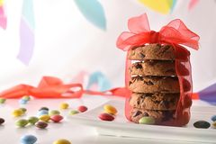 Party with stack of chocolate cookies with red bow front royalty free stock photos