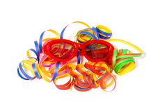 Party streamers and funny glasses. Isolated on white background stock photo