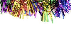 Party Streamers. A pile of party streamers against a white background that leave copy space stock images