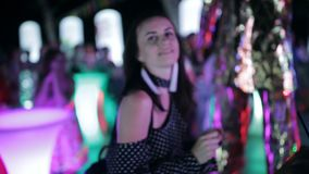 Party on the street. Girl dancing in the crowd at an outdoor disco. The dancing girls in a disco. Party on the street. Girl dancing in the crowd at an outdoor stock video footage