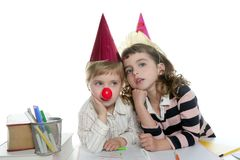 Party student two little school girls. Party student two little girls with hat and clown nose Royalty Free Stock Photography